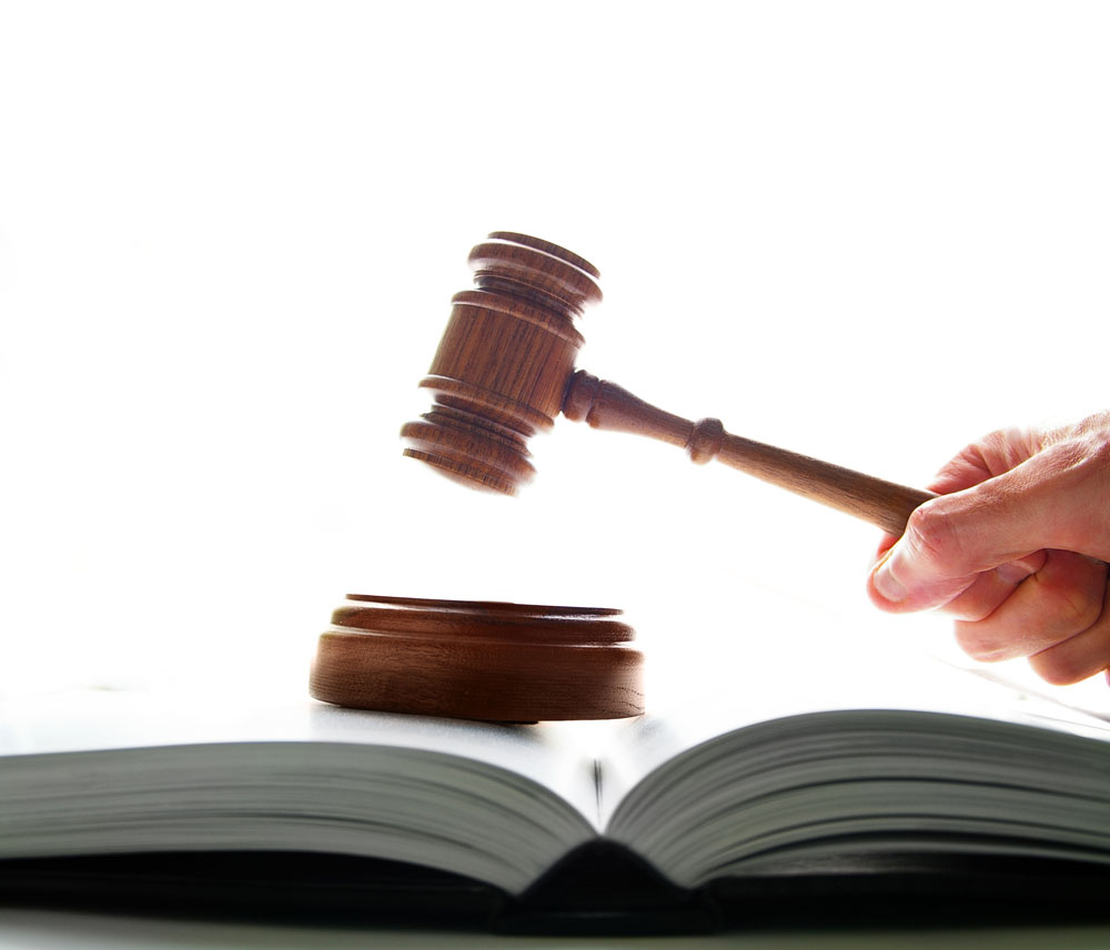 judges court gavel being pounded on a lawbook